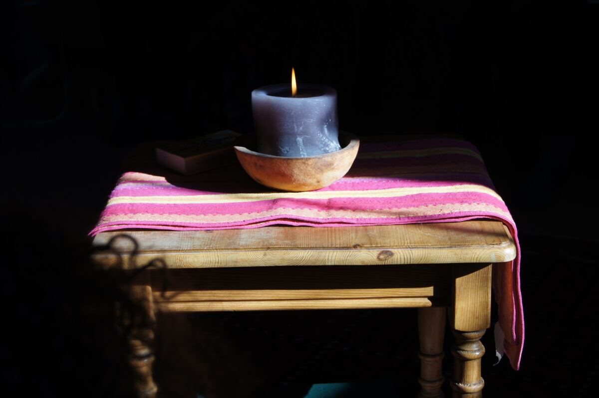 Image of candle on old wooden table